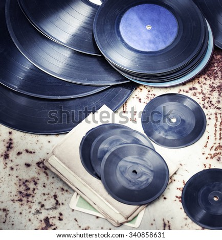 Records over rusty background  / selective focus - stock photo