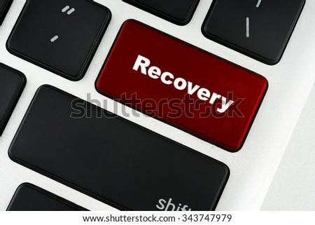 Recovery text on red keyboard button - financial, business, online and data concept - stock photo