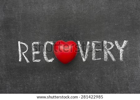 recovery word handwritten on blackboard with heart symbol instead of O