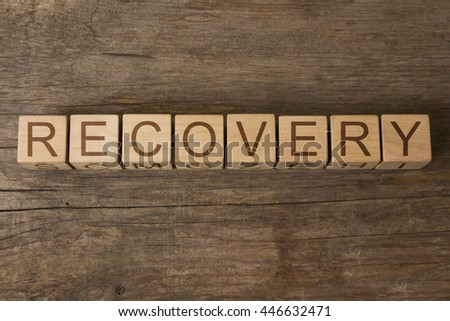 Recovery word written on wooden cubes - stock photo