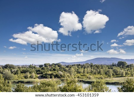 Recreation Area Wienerberg Park with meadows, groves, farmland, ponds, dog area, playgrounds and even a golf club located in the 10th district of Vienna. It was a former Imperial brick manufactory. - stock photo
