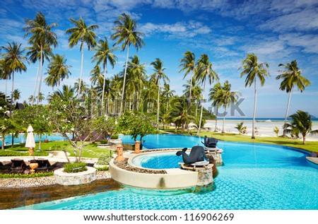 Recreation area with swimming pool on the tropical beach - stock photo