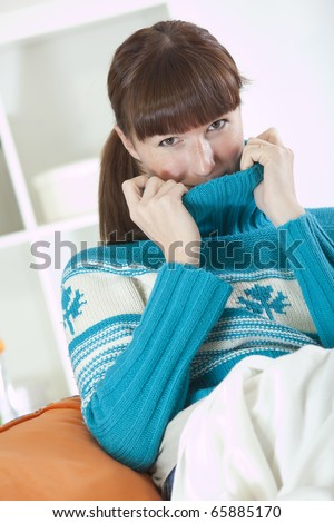 recreation at home - young woman in neck knit jumper