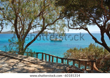 Recreation sail yacht at the beach of luxury hotel, Crete, Greece - stock photo