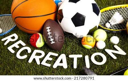 Recreation word with sports equipment  - stock photo