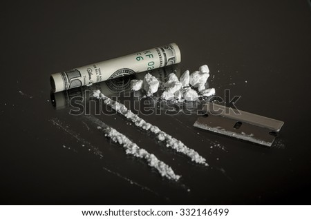 Recreational Drugs on Glass Table - Substance Abuse Concept