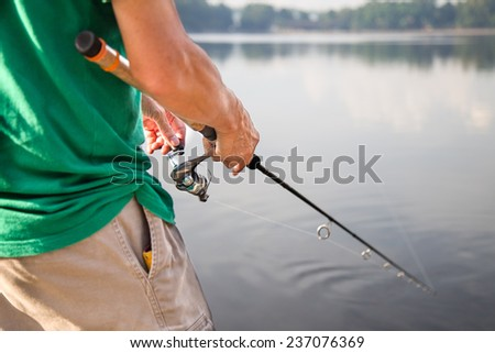 Recreational fishing on a beautiful morning - stock photo