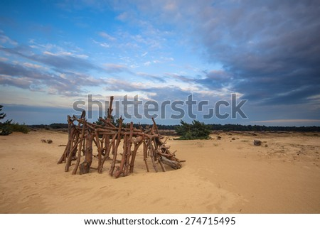 Recreational hut built by children as a school holidays pursuit in the dunes of National park Hoge Veluwe near Arnhem in the Netherlands - stock photo