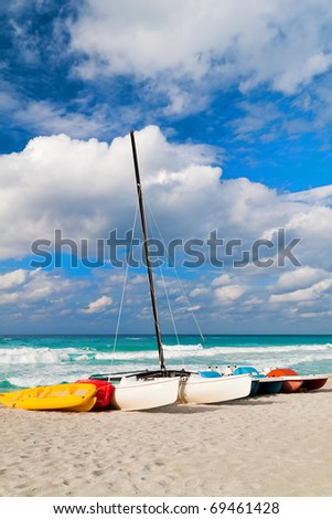 Recreational renting boats landed on the shore of a beautiful tropical beach - stock photo