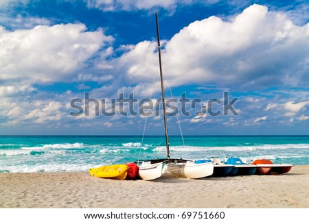 Recreational renting boats landed on the shore of the beautiful cuban beach of Varadero - stock photo