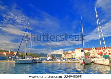 Recreational sail boats at anchor in traditional harbor on the Adriatic sea, Trogir, Croatia - stock photo