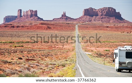 Recreational vehicle entering monument valley, utah - stock photo