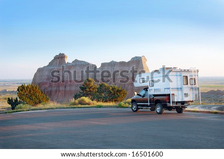 Recreational Vehicle in the Badlands National Park, South Dakota. - stock photo