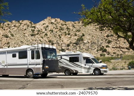 recreational vehicles parked at an interstate rest area in Arizona