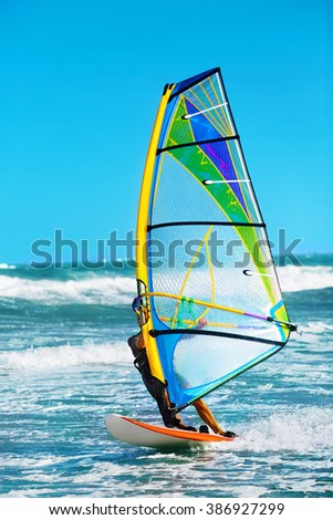 Recreational Water Sports. Windsurfing. Windsurfer Surfing The Wind On Waves In Ocean, Sea. Extreme Sport Action. Recreational Sporting Activity. Healthy Active Lifestyle. Summer Fun Adventure. Hobby - stock photo