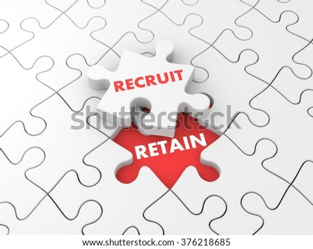 Recruit and retain. Business metaphor with puzzles - stock photo