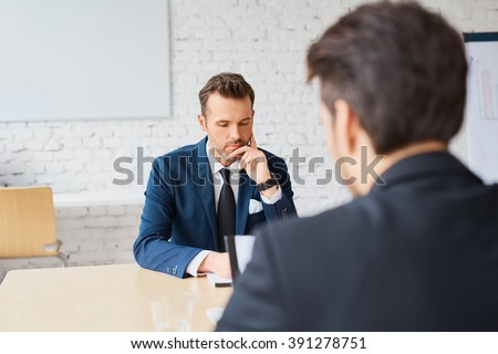 Recruiter and candidate during job interview - stock photo