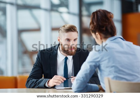 Recruiter asking questions during job interview - stock photo