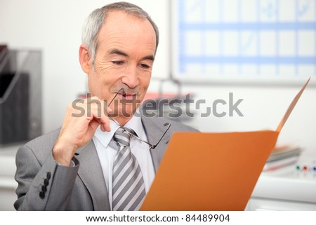 Recruiter reading job application - stock photo