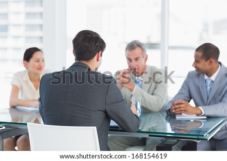 Recruiters checking the candidate during a job interview at office - stock photo
