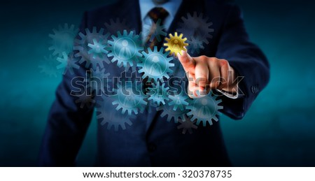 Recruitment consultant is selecting a small golden cog wheel embossed with a female worker icon from a host of virtual cogs forming a gear train. Concept for human resources decision and hiring. - stock photo