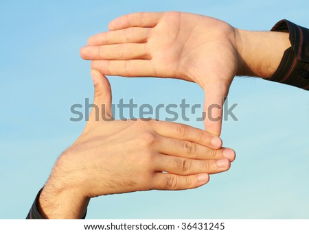 rectangular frame of the human hand - stock photo