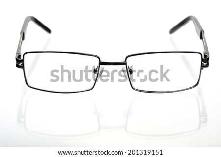 Rectangular glasses in a thin metal frame on a white background  - stock photo