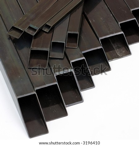 rectangular welded steel  pipes on white background - stock photo