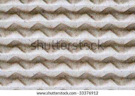 Recyclable textured paper. Abstract pattern of reused paper - stock photo