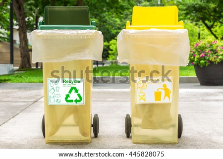 Recyclable waste green trash bin and general waste yellow trash bin. - stock photo