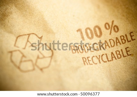recyclage pictogramme written on a brown recycled paper with copyspace