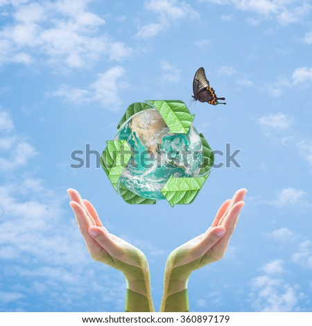 Recycle arrow sign leaf around aqua green globe over beautiful woman human leaf hand on blur abstract blue sky background: Recycle reduce reuse csr idea concept: Elements of image furnished by NASA - stock photo