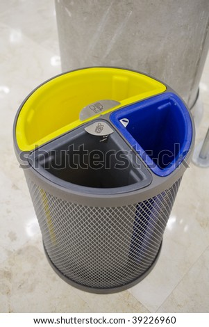 recycle bin in blue yellow and grey - stock photo