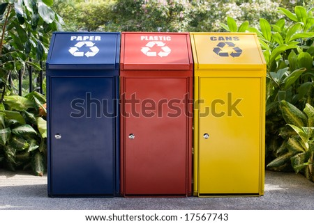 recycle bins in blue yellow and red - stock photo