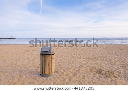 recycle bins on the beach. concept photo of a clean beach - stock photo
