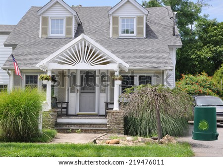 Recycle Can American Flag Suburban Cape Cod Style home landscaped USA residential neighborhood - stock photo