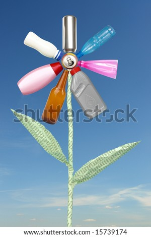 Recycle flower created from beer can, plastic and glass bottles and waste paper stem spelling reduce-reuse-recycle over blue sky - stock photo