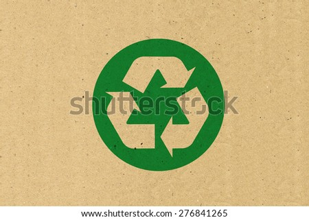 Recycle logo on brown paper - stock photo