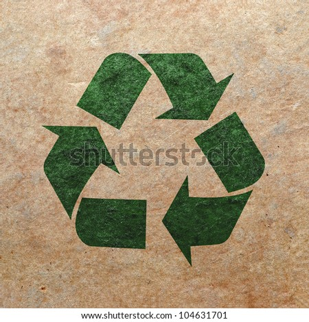 Recycle logo on old paper - stock photo