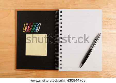 recycle notebook open with pen , Paper clip and post it paper note