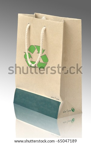 Recycle paper bag with recycle symbol and reflect - stock photo