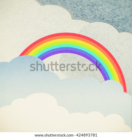recycle paper cloud and rainbow - stock photo