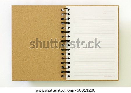 Recycle paper notebook first page on white background - stock photo