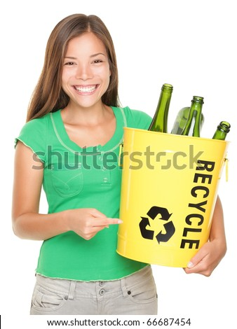 Recycle! Recycling woman pointing at recycle icon on bin with glass bottles. Caucasian / Asian girl isolated on white background. - stock photo