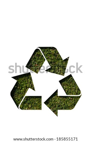 recycle sign on grass - stock photo