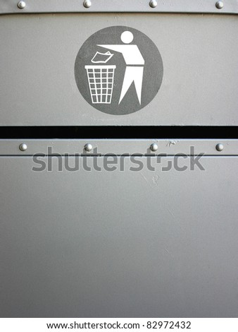 recycle sign on metal wastepaper - stock photo