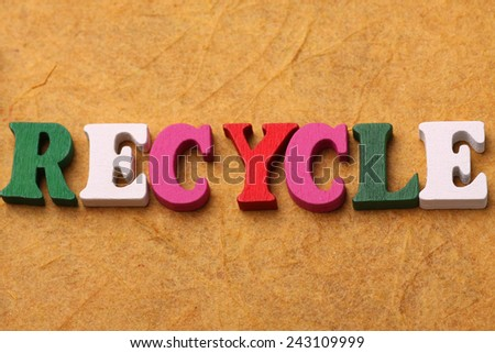 RECYCLE sign with colorful word concept - stock photo