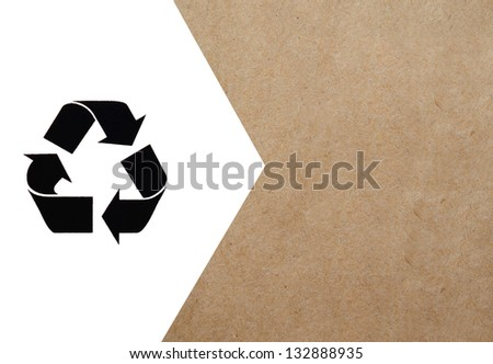 Recycle symbol on cardboard background