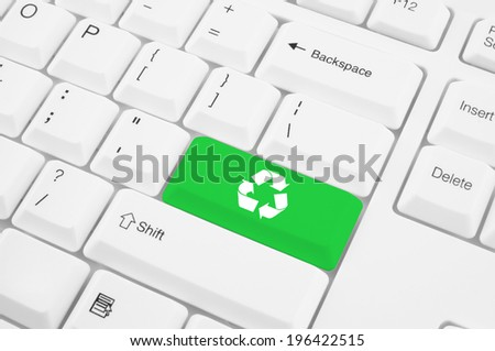 Recycle symbol on computer keyboard - stock photo