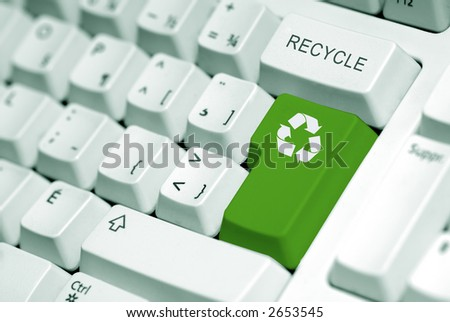 recycle symbol on the computer keyboard in green - stock photo
